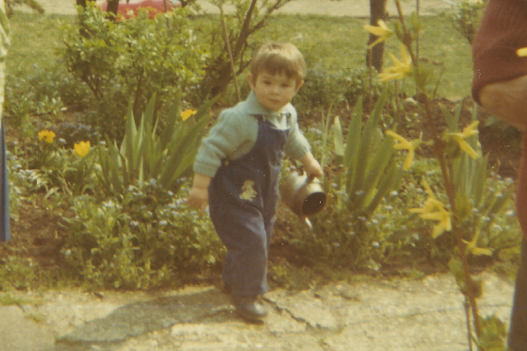 Adam Frost as a child with watering can