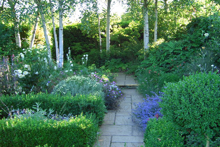 Pathway leading through a garden designed by Adam Frost