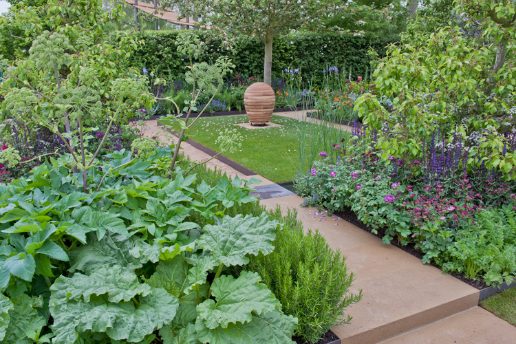Planting and beehive in Chelsea garden designed by Adam Frost
